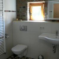 Bad mit Fußbodenheizung und Handtuchtrockner